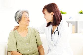 nurse and elderly woman sitting